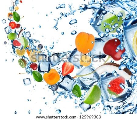 Fresh fruit splash with ice cubes - stock photo