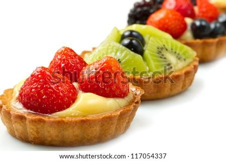 Fresh fruit tart on white background - stock photo