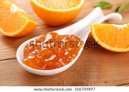 fresh fruit with orange jam - stock photo