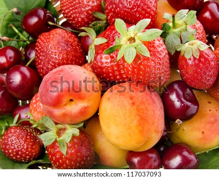 fresh fruits and berries mixed collection surface close up macro shot - stock photo