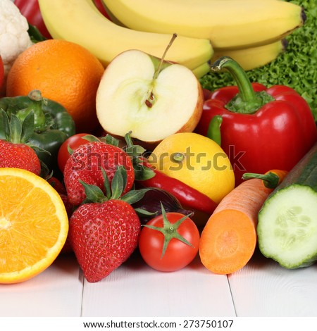 fresh fruits and vegetables like oranges, apple, tomatoes, banana, strawberry - stock photo