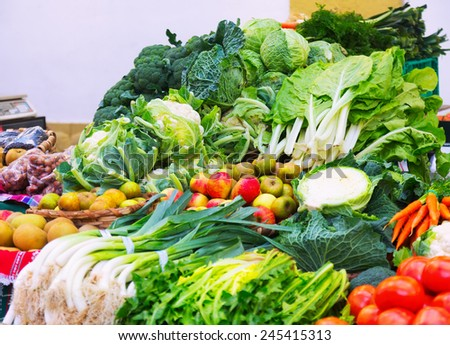 Fresh fruits and vegetables on  market counter - stock photo