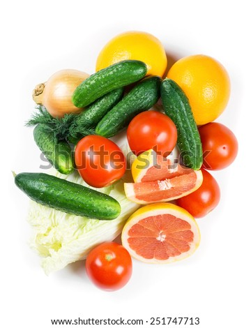 Fresh fruits and vegetables on white background - stock photo