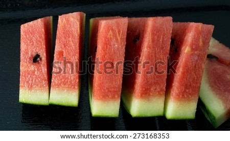 Fresh Fruits, Close Up of Ripe and Sweet Refreshing Watermelon on A Black Plate. - stock photo