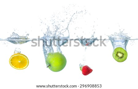 Fresh fruits falling into water with splashes - stock photo