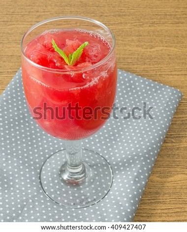 Fresh Fruits, Glass of Ripe and Sweet of Refreshing Watermelon Juice Served with Mint Leaves. - stock photo