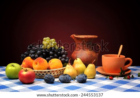 Fresh fruits in wicker baskets and pottery - stock photo