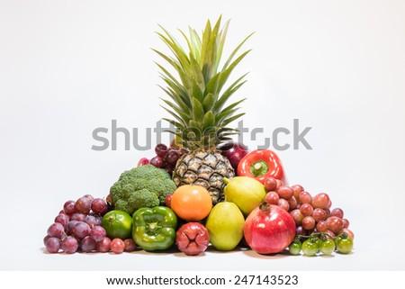 Fresh fruits isolated on white - stock photo