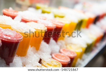 Fresh fruits juices chilled in ice - stock photo