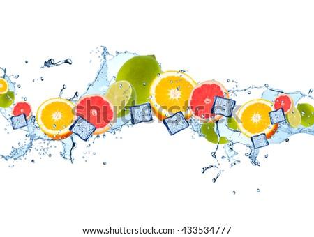 Fresh fruits, lime, orange and grapefruits falling in water splash, isolated on white background - stock photo
