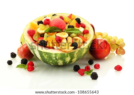 fresh fruits salad in watermelon, fruits and berries, isolated on white - stock photo