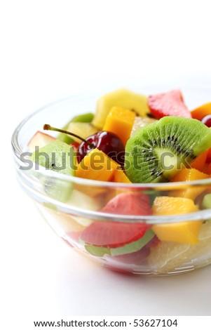 Fresh fruits salad on white background - stock photo