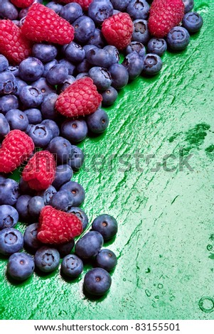 Fresh fruits (strawberries, blackberries)on wooden background. Still life with copy space. - stock photo