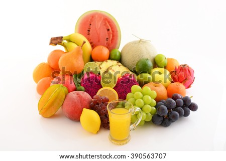 Fresh fruits with a glass of juice - stock photo
