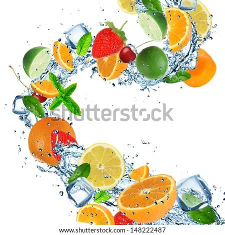 Fresh fruits with water splashes on white background - stock photo