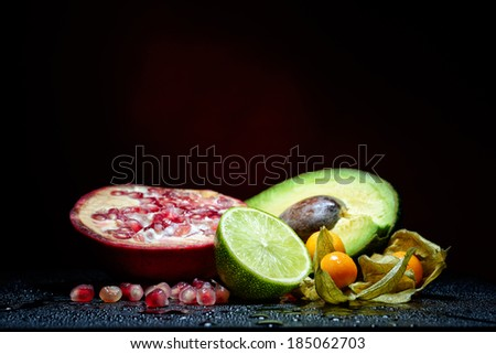 fresh fruits with waterdrops on them and knife - stock photo