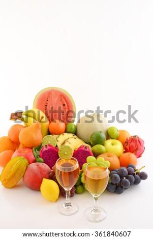 Fresh fruits with wine - stock photo