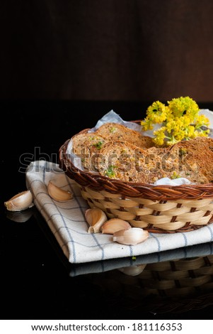 fresh garlic bread with herbs in basket homemade - stock photo