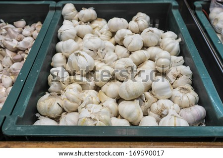 fresh garlic sell in supermarket - stock photo