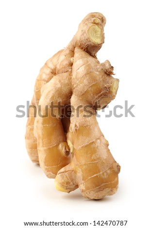 fresh ginger on a white background - stock photo