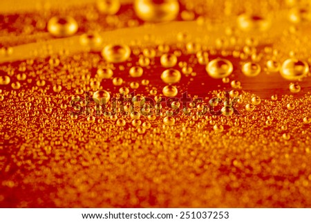 Fresh glass of beer with bubbles - stock photo