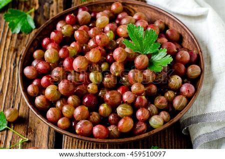 Fresh gooseberries in a bowl - stock photo