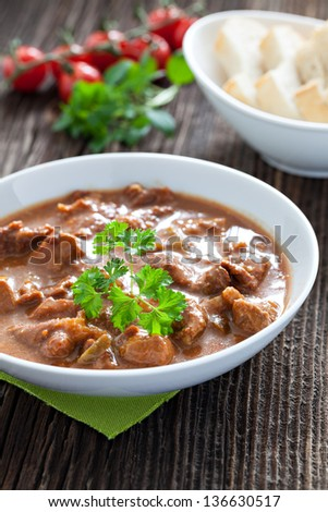 fresh goulash with bread - stock photo