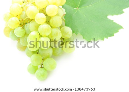 fresh grape fruits closeup with green leaves isolated on white background - stock photo