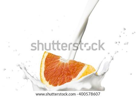 Fresh Grapefruit Falling On Milk Splash - stock photo