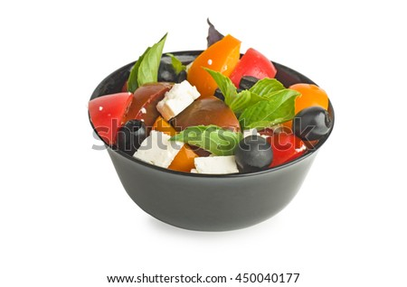 Fresh Greek salad in a bowl isolated on white background - stock photo