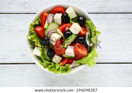 Fresh Greek salad in a bowl, top view - stock photo