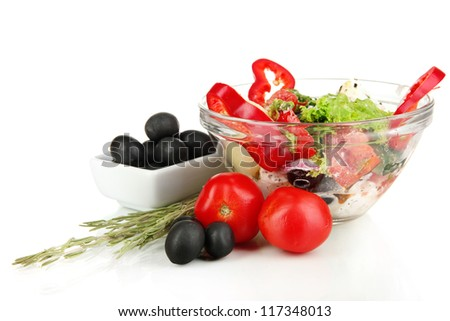 Fresh greek salad in glass bowl isolated on white - stock photo