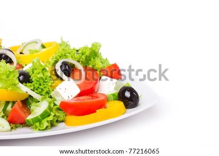 Fresh greek salad on the white background - stock photo
