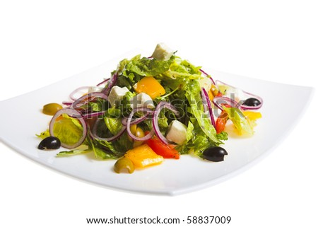 fresh Greek salad on white plate - stock photo