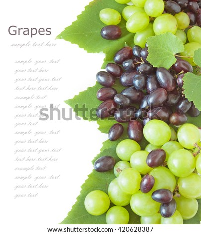 Fresh green and red grapes with leaves. Isolated on white - stock photo