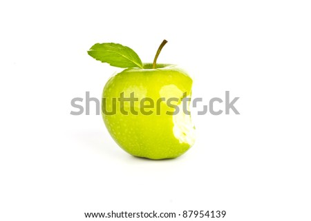 Fresh green apple  with a bite  isolated on white background - stock photo