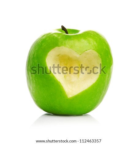Fresh green apple with cut off heart shape. - stock photo