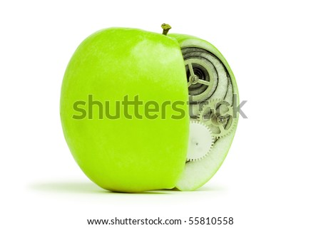 fresh green apple with mechanism inside concept - stock photo