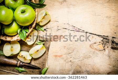 Fresh green apples in the basket with knife . On a wooden table. Free space for text . Top view - stock photo
