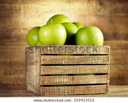 fresh green apples in wooden box - stock photo