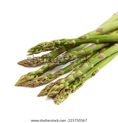 Fresh green asparagus isolated on a white background. - stock photo