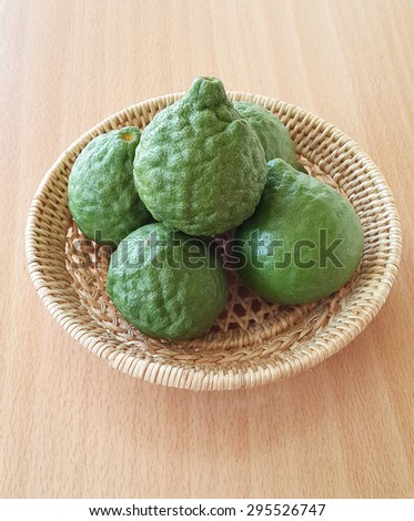 Fresh green bergamot fruit with great compose in basket - stock photo