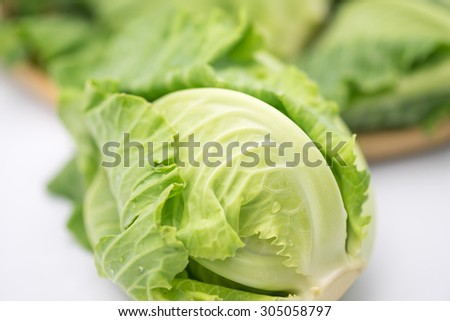 Fresh green Brussel sprout for healthy diet on white background - stock photo