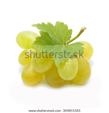 Fresh green grapes with leaves - stock photo