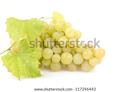 Fresh green grapes with leaves isolated on white - stock photo