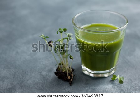 Fresh green juice in the glass for detox, selective focus - stock photo