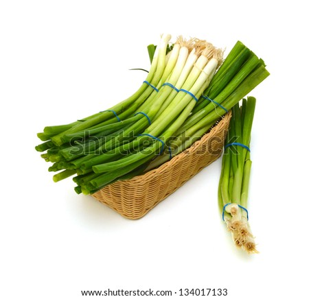 fresh green onions in basket on a white background - stock photo