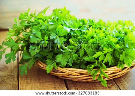 Fresh green parsley on wooden old background - stock photo