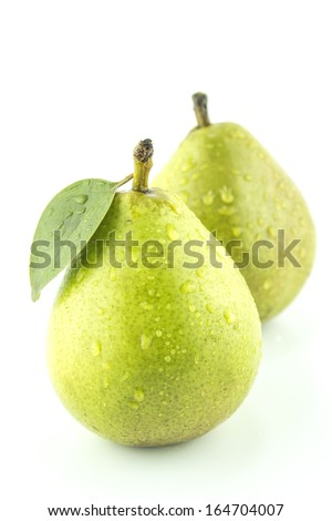Fresh Green Pears with leaf on white  - stock photo