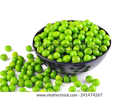 Fresh green peas in a bowl and on the table, on white background - stock photo